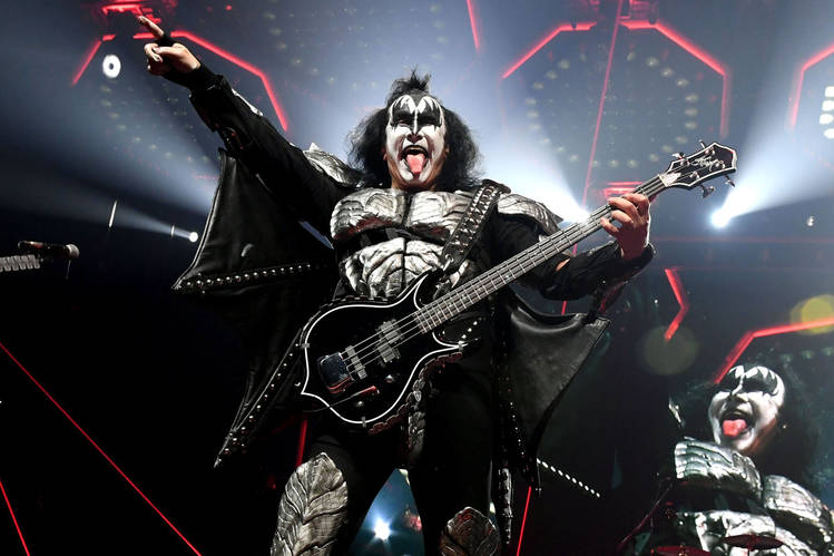 'Money is the blood and the fuel that powers Earth. Even God passes the hat around,' says Gene Simmons, shown onstage with KISS earlier this month.
