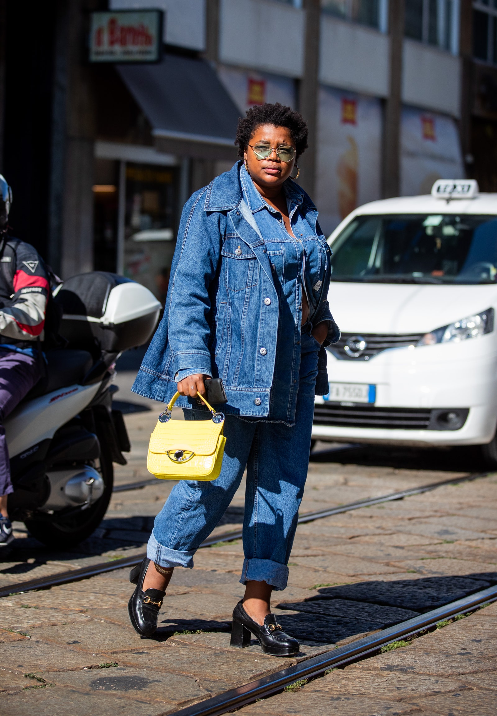 A guest is seen wearing denim jacket and jeans yellow bag outside the Pucci during Milan Fashion Week SpringSummer 2020...