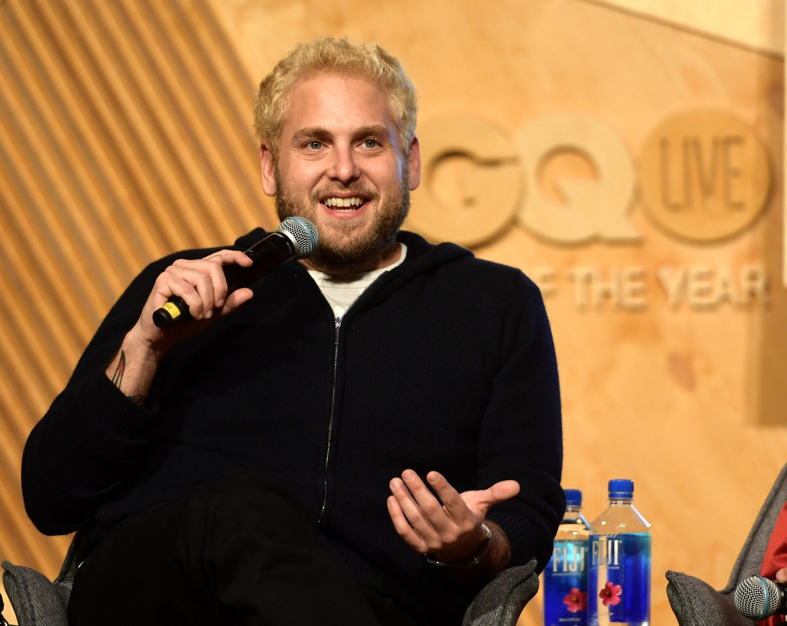 Image may contain Human Person Electrical Device Microphone Jonah Hill Crowd and Finger